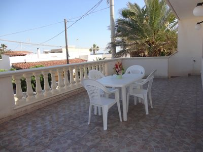 Photo for Large and comfortable apartment overlooking the sea on the seafront of Salento