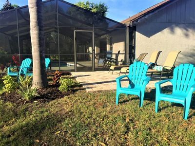 side view of home, pool, area by lakefront sundeck, chairs, full sun face south