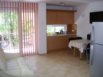 Photo for Modern apartment with air-condition, pool and barbecue for 4+2 people, free WIFI