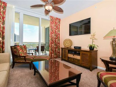 Photo for Tropical End Unit! Beach View, Tons of Resort Amenities. Free Beach Service