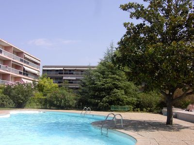 Photo for T1 sunny with terrace and private garden in park with swimming pool. Pkg. .