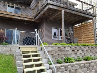 View of stairs to private patio and unit