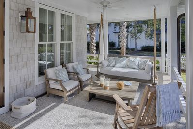 Relax with friends on this oversized porch with daybed swings (there are two!)
