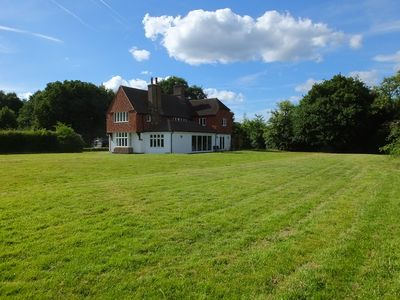Photo for Luxury Family Home // Set in 3 acres // 5 mins to Guildford // 30 mins to London