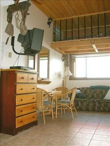 Photo for Shaw Direct Satellite TV... Excellent ski-in and ski-out ... 'Old West' Decor