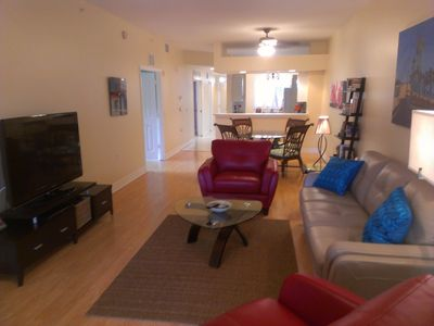 52' TV living room with open concept. Great cross breezes and light!