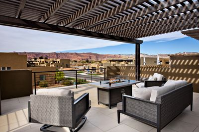 Front Patio Views of Snow Canyon - Stay warm next to the fire pit and relax while watching the sunset over the red mountains.