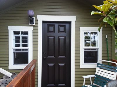 Front door and a sweet deck made for two.