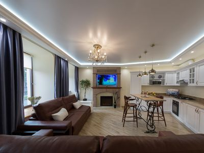 Photo for St. Petersburg center walks and serene nights at  water-view elegant apartment.
