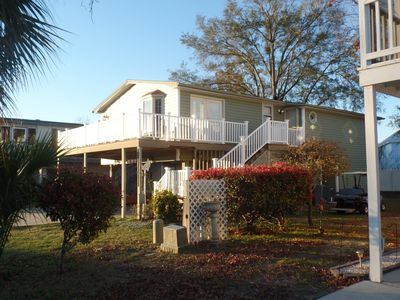 Photo for Free Wi-Fi, Golf Cart, Private Beach Parking, 2 Complete Living Areas and more!