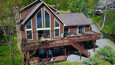 Impressive Mountain Home in prestigious community offers beautiful lake views