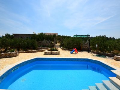 Photo for This 2-bedroom villa for up to 4 guests is located in Povlja and has a private swimming pool, air-co