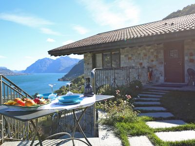 Photo for Charming attic with stunning lake view, garden and parking: feel like at home!