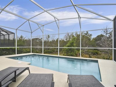 Photo for Nestled in the gated golf resort community of Reunion close to Disney and the attractions