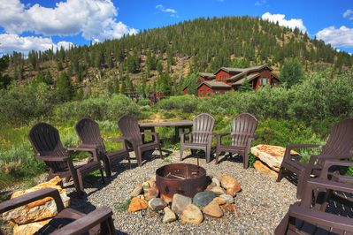 Private fire pit with plenty of seating for friends and family