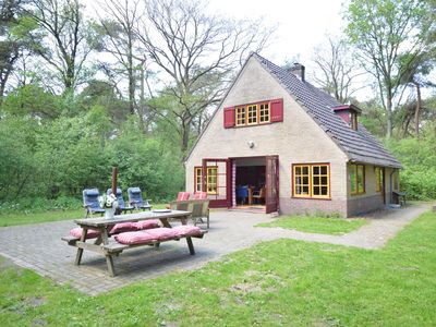 Photo for Detached holiday home with open fireplace in magnificent forest