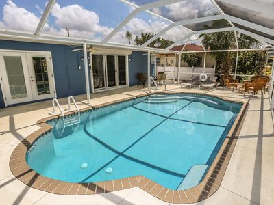 Photo for Remodeled Pool Home, Mid Island location only Steps to the Beach