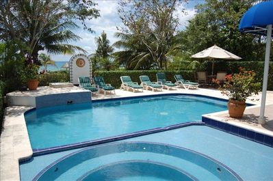 You can see the ocean beyond the private fresh wter pool.