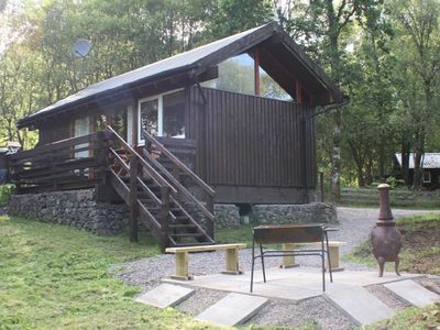 Photo for A charming cabin with wood burning stove,  hot tub and stunning loch views.