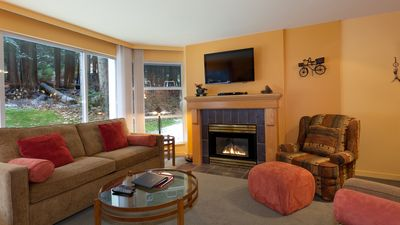 Cozy living area with gas fireplace, flat screen TV