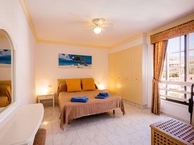 Photo for Sunny Duplex Apartment - FREE WIFI with views over Los Cristianos to the Sea