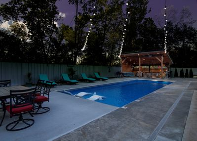 Pool, outdoor kitchen, lounge & dining area