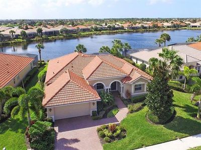 Luxury Lake Side Home at Venetian Golf & River Club with heated salt water Pool