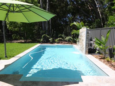 Photo for 15 Naiad Court - Modern, beautifully decorated, lowset home with swimming pool. Close to beach.