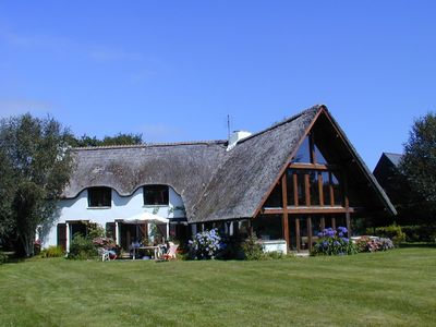 Photo for Large cottage at the coast of an inlet