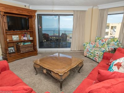 Photo for Ir 616 - 2 BR that sleeps 8 and sits beachside - Sunset Views!