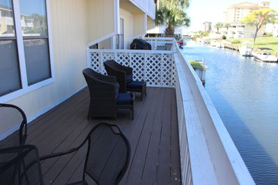 New chairs and cushions each with their own ottoman so put up your feet, relax and enjoy the view from this private, expanded deck overlooking the canal.