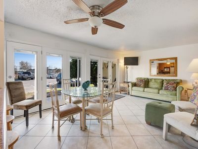 Photo for NEW LISTING! Inviting condo w/ three shared pools and two tennis courts!