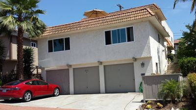 Only a 5 minute walk to the beach and downtown. Garage and driveway parking.