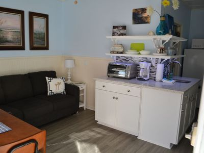 Lots of updated decor in this condo!  Love the recycled glass counter tops