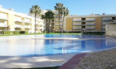 Photo for 2 bedroom apartment w / pool, free wifi, near the Marina