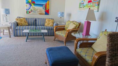 Photo for Comfy, colorful 2 bedroom oceanfront condo with free WiFi, cute beach decor, an outdoor pool, and a game room located midtown just steps to the beach!