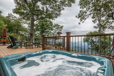 Sunken hot tub on back deck with amazing views