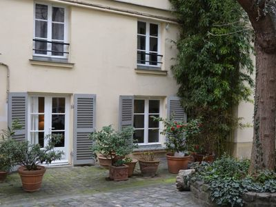 Photo for At the heart of the Marais, charming studio walk-in a beautiful garden courtyard