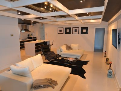 high end contemporary cool w/ loungers, flat screen tv and bar/kitchen
