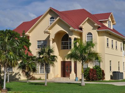 Photo for Executive home 5 mins drive from world famous Seven Mile Beach w/ Swimming Pool