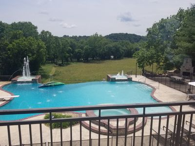 View of Pool, field, and James River from upper back deck of main house.