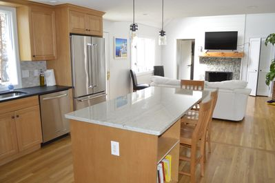 Sunny, open concept kitchen. Well stocked.