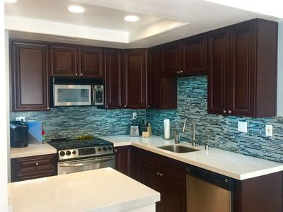 Photo for Completely Remodeled!! Blocks to racetrack and beach, AC, wash/dryer & pool/spa
