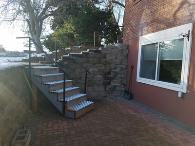 6 non slip steps to patio of daylight basement, also handrails