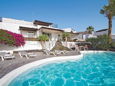 Photo for 4 bedroom Villa, sleeps 8 in Puerto del Carmen with Pool, Air Con and WiFi