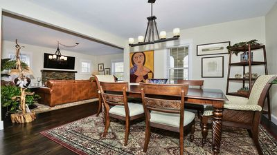 Dining room with wooden table and oversized chairs