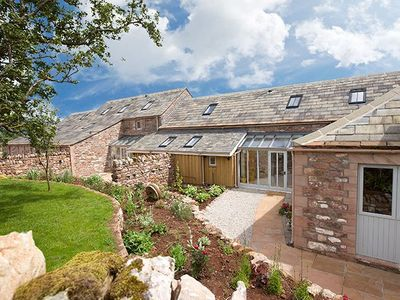 Photo for A traditional stone barn from 1726 converted into an award winning property.