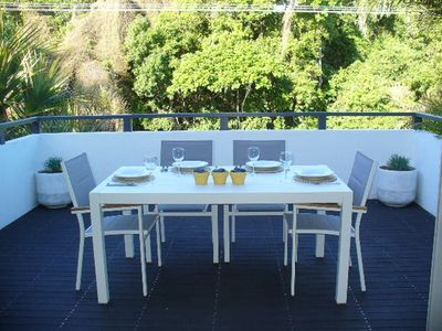 Outdoor deck is also leafy & peaceful