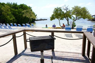 Several charcoal grills and picnic areas throughout the property