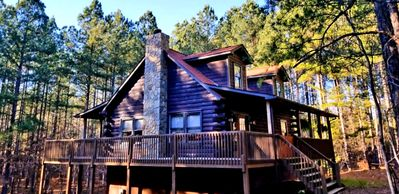3 story ,large, open log cabin surrounded by acres and acres of woods/ mountains